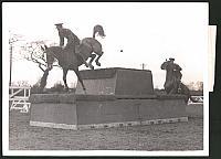 old postcard: Fotografie Royal Tournament at the Olympia, Reiter der Weedon School of Equitation beim Ritt über Hinderniss